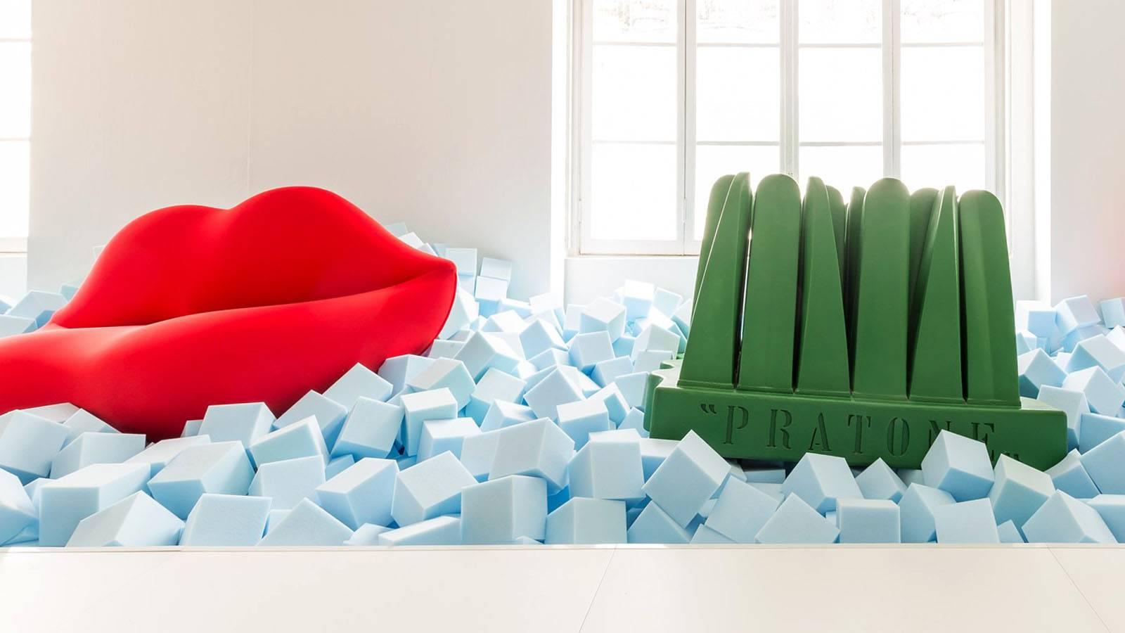 Gufram furniture pratone and bocca presented as an art installation