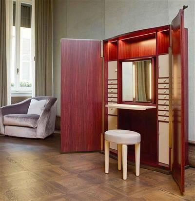 Promemoria Furniture: Alchemico Lei: wide wooden wardrobe with leather shelvings, with open doors an