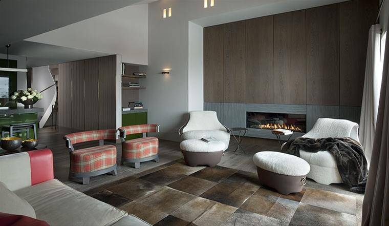 Promemoria Furniture: Interior of a living room with a fireplace in a house in Austria.