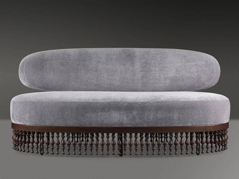 Bruno Moinard Furniture for Promemoria, grey couch with elegant wooden legs.
