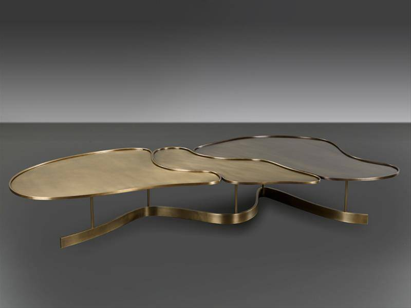 Bruno Moinard Furniture for Promemoria, low golden oval table on a grey background.