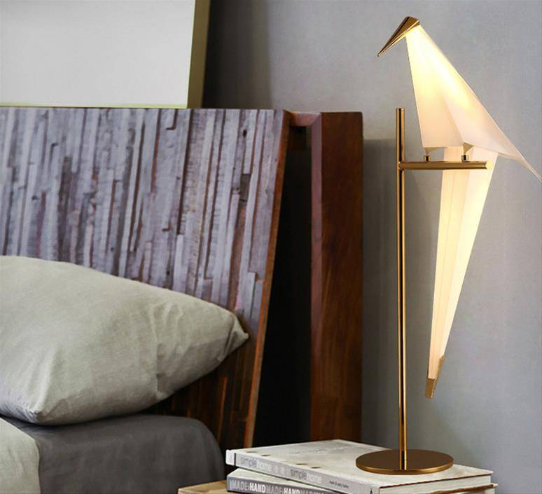 An example of a bird from the Moooi Perch lamp on a night table