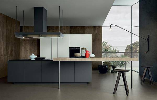 Kitchen and island with a wooden table and lacquered furniture in grey