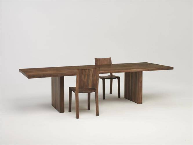 Day by Day table in dark wood on a white background with two chairs.