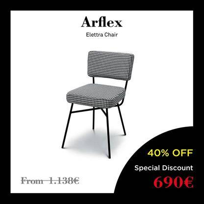 arflex elettra chair black tubing and is adorned by cushions made in a sage shade of green